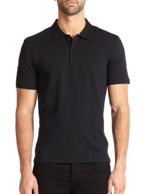 Image of This classic polo of soft, slim-cut cotton is a definite wardrobe staple. Polo collar. Button placket. Short sleeves. Cotton. Machine wash. Made in Italy.
