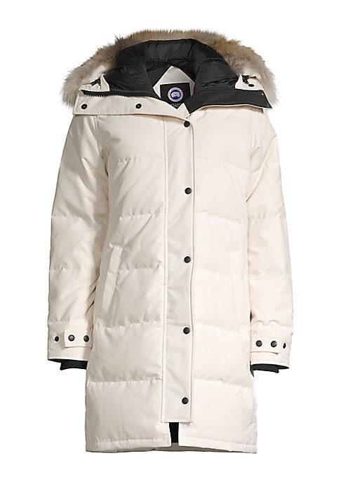 Image of Water and windproof parka made with plush fur trim on the hood. Adjustable drawcord hood. Long sleeves. Adjustable snap cuffs. Concealed front zip with snap closure. Two waist slip pockets. Back vents with snap closure. Removable fur trim. Nylon lining. P