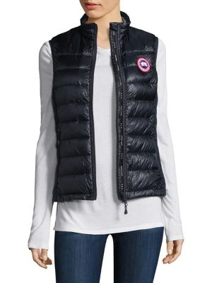 Image of A down-filled yet lightweight packable vest featuring signature Canada Goose design details and a shape-enhancing silhouette. Stand collar. Reflective tape at back collar for visibility. Sleeveless. Two-way zip front. Zippered slash pockets. Packable into