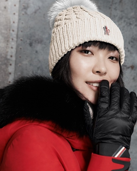 Moncler womens red puffer jacket with fur pom hat and black moon boots at  saks. 8da347aaa5ef